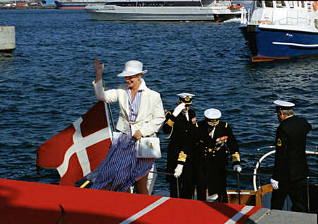 prince of denmark: DENMARK  COPENHAGEN_  (Files historic images )Queen Margrethe II and prince Henrik boading at boad to board on danneborg (royal yatch) on July 14, 1999      Editorial