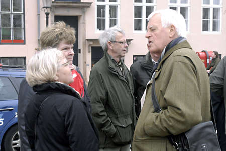 getting together: DENMARK  COPENHAGEN _ Danish seniors (retireed people) getting together for Copenhagen History Tour guided by history guide through Copenhagen city today on 6 April 2011         Editorial