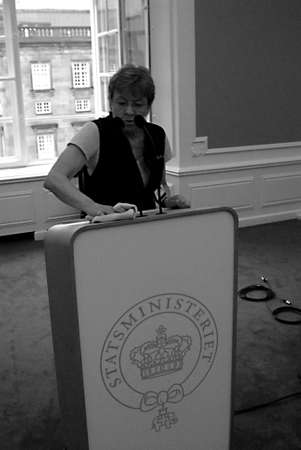 eldlery: DENMARK  COPENHAGEN _  Eldlery female cleaning assistant cleaning prime minister conference table before his press conference about Danmarks reformpakken 2020 at mirroe hall cghristiansborg today on tudesday 12 April 2011