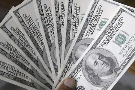 KASTRUPCOPENHAGENDENMARK _ USA dollars bills (paper money notes)in hundred 14 April 2011