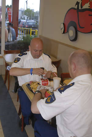 NETHEERLANDSzOESTERMEER _Dutch policeofficers bought and will enjoy eating  Mcodonalds fast food menu in McDoanlds fast food  restaurant while on duty  22 April 2011