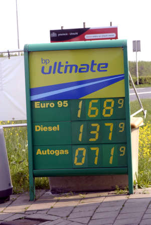 holand: NETHEERLANDS    COUTRY SIDE Comsuner pumping fuel or gasoline at BP british oil cmpnay gas station in Holland Netherlands little higher then Germany 23 Aoril 2011 Editorial