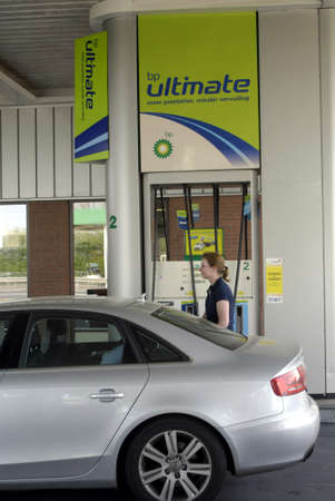 NETHEERLANDS    /COUTRY SIDE /Comsuner pumping fuel or gasoline at BP british oil cmpnay gas station in Holland /Netherlands little higher then Germany 23 Aoril 2011   Stock Photo - 9386909
