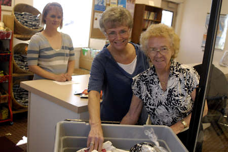 stock agency: LEWISTONIDAHO STATE USA _American senior female helping in Community action partnership food bank relieving hunger in North Central Idaho state,10.1 percent of all households in Idaho donot hve enough food 60 percent of the audlt and 33 percent of the c