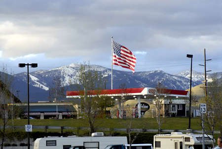 travler: MISSOULA  _ MONTANA STATE _  US flag star and stripe fly over city 16 May 2011        Editorial