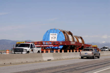 MISSOULA  _ MONTANA STATE _Tow  Mega loads (oversize load ) parked interstate state 90 ,Montana citizen want to ban mego load from highway in future might be comming up by voting to ban Mega load on highways 18  ay 2011