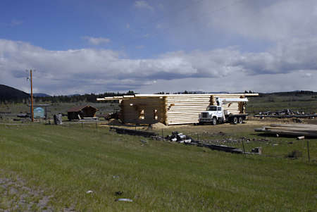 travler: country side  _ MONTANA STATE _ American mostly build house in wooden  house like wooden ranch 17 May 2011         Editorial