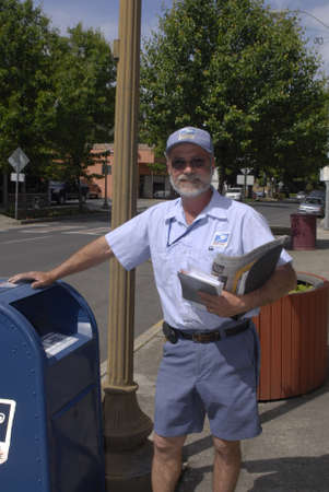 mail man: LEWISTONIDAHO STATE USA _  uNITED sTATES POSTAL SERVICE ,USA MAIL MAN OR POST MAN WITG POST 25 MAY 2011