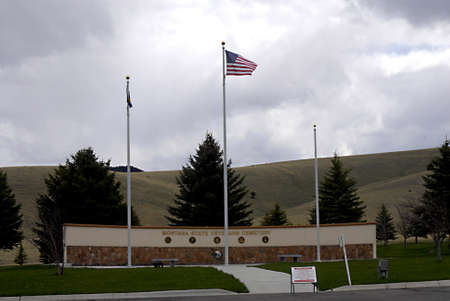 travler: OUTSKIRTS HELENA  _ MONTANA STATE _ USA flag flys over Montana State veteran s cemtry on 17 May 2011