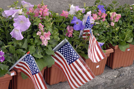 LEWISTONIDAHO STATE USA _ American are celebrating memorial day weekend  flowers are attached with USA Flags for this week and actual day is on monday memorial day, but american start buying for flowers for memorial day weekend 26 May 2011