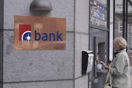cashing: DENMARK  COPENHAGEN _Danish female cashing money at Banknord atm money auomate 24 June 2011           Editorial