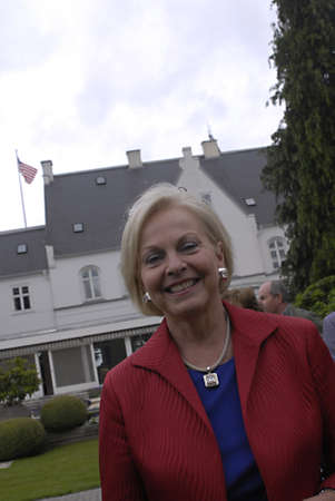 ambassador: DENMARK  COPENHAGEN _  Louri S. Fulton american ambassador to Denmark invited about 1.500 danes  and other guest to celebarte 4th of july at her residence in Copenhagen,with USa Amry attachie Chris Macdonald  in trops dress welcome guest and read USA pre