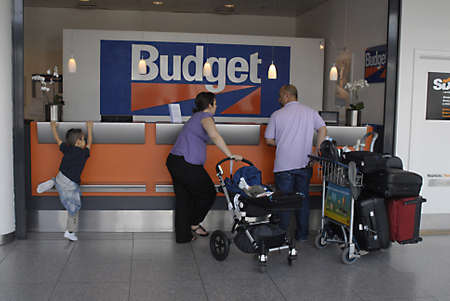 KASTRUP/COPENHAGEN/DENMARK _ Consumers at Budget  Car Rental desk at Copenhagen International Airport  today on sunday 10 July 2011       Stock Photo - 9880643