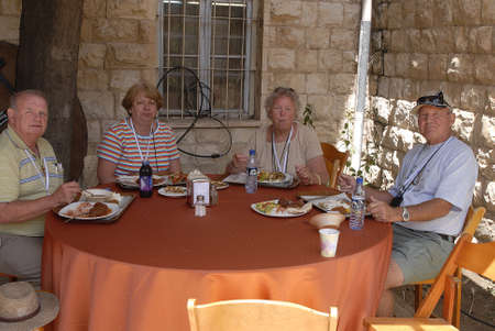 francis joseph dean: Amerian elderly tourist couples visit holyland and enjoying lunch   May 8,2006     Editorial