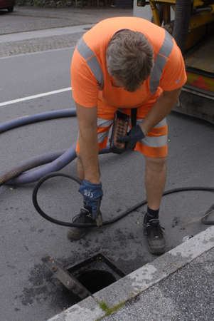 strom: KASTRUPCOPENHAGENDENMARK _ Taarnby county worker cleaning  the storm  drain tow weeks ago nations was shock due to very heavy ligthening and storm and rain and millions of kroners cast to nation and insurance compnaies  cost millions and today is  predi Editorial