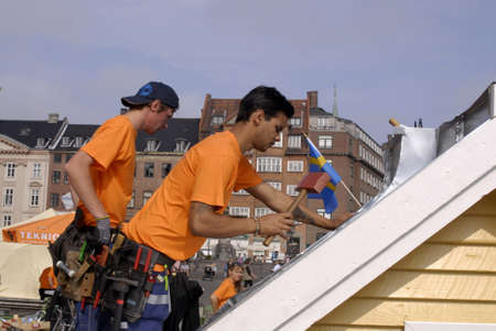 coppers: COPENHAGEN _DENMARK.   Swedes and Danes compete with nails and hammers   home builder zink and coppers at nytorv tdoay 26 August 2011