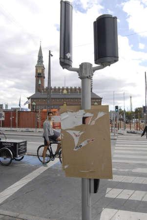 polictis: DENMARK  COPENHAGEN _Vandalized elections poster still hang on poles 2 Sept. 2011