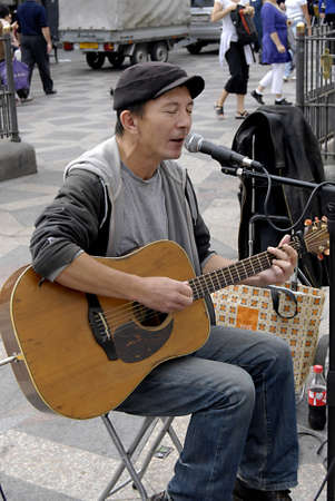 jones: COPENHAGEN _DENMARK.  Street preformer singer Pter Jones singing on stroget  entertain and try to selling his CD 4 Sept.2011               Editorial