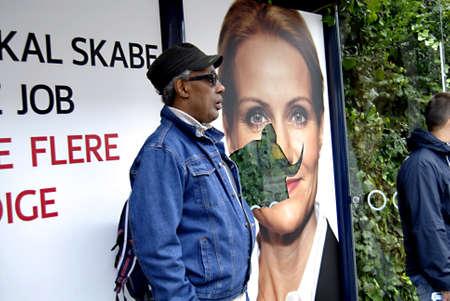 democrat party: DENMARK  COPENHAGEN _ SOCIAL DEMOCRAT PARTY LEADER HELLE THORNING SCHOMIT ELECTIONS BILLBOARD BEEN VANDALIZED AT BUS STOP JEGVEJ NORREBRO ARE OF COPENHAGEN 7 SEPT.2011