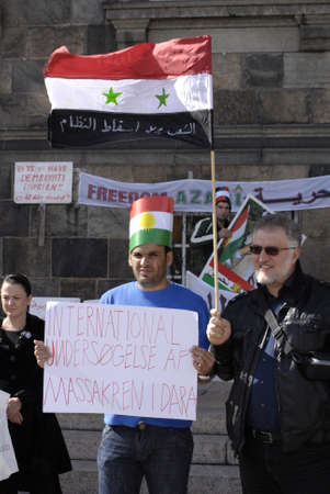 assad: DENMARK  COPENHAGEN _ Handful syrian immigrants living in Denmark staged proest rally gainst Syrian government and president Assad , proetst infront of danish parliament christiansborg slot plads today 0n 9 Sept,2011