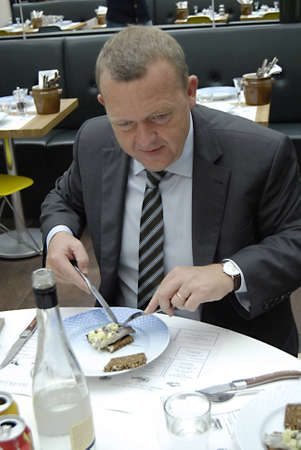 DENMARK  COPENHAGEN _  Denmarks prime minister Lars Lokke Rasmussen, tivoli garden  lunch with Food Club(madklubben) I vote for  liberal partyprime minister define his aprty as Mordern  Labour Party ,Prime minister on road with his election compaign, to Editorial