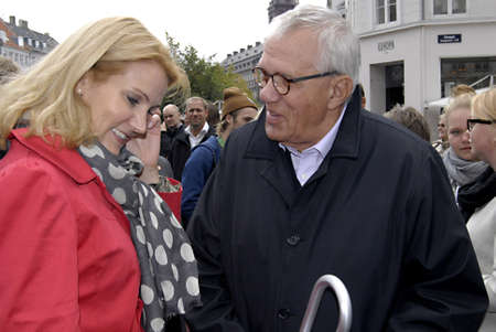 helle thorning schmidt: DENMARK  COPENHAGEN _ Social democrat leader and candidate for prime minister post (in red) greets wateran social democrat and fomer minister in various ministries in social demiocrat government Knud Heinesen on her election compaign at Amager torv today