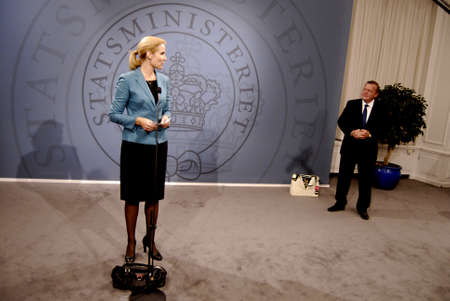liberal: DENMARK  COPENHAGEN _ Ms.Helle Thorning_Schmidt first ever female prime minister of Denmark took over primce minister office from acting prime minister Lars Lokke Rasmussel(Lars L�kke Rasmussen)with ceremony in Mirror Hall at prime ministry Christiansbor