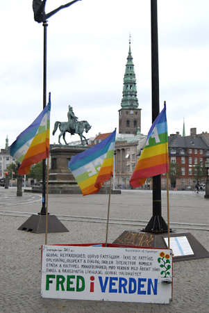 polictis: DENMARK  COPENHAGEN _Peace activest with their rainbow flags infrom of danish parliament christians anti war activiests 6 Oct. 2011     Editorial