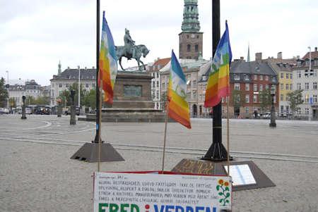 anti war: DENMARK  COPENHAGEN _Peace activest with their rainbow flags infrom of danish parliament christians anti war activiests 6 Oct. 2011