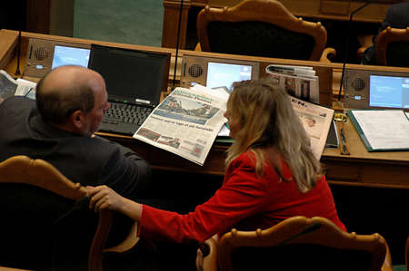 parliaments: DENMARK  COPENHAGEN _ Newly elected members of daanish parliament reading ext messages ,read newspapers and work on laptops  during debate session in parliament folketinget on first debate day 6 Otc. 2011