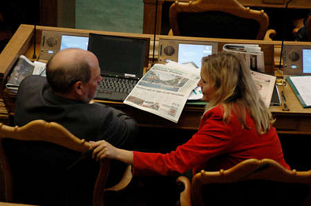 parliaments: DENMARK  COPENHAGEN _ Newly elected members of daanish parliament reading ext messages ,read newspapers and work on laptops  during debate session in parliament folketinget on first debate day 6 Otc. 2011       Editorial