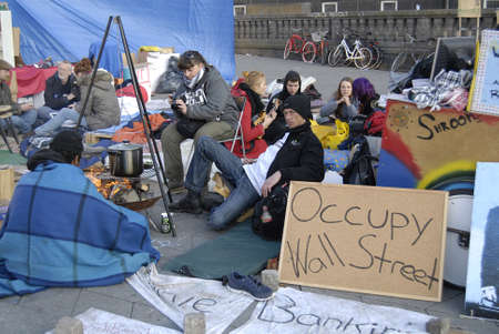 occupy wall street: DENMARK  COPENHAGEN _ Few danes have Occupied Infront of Copenhagen City Hall in conection sympthaized with United States Occupy Wall Street 17 Oct. 2011       Editorial