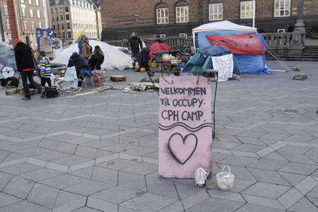 conection: DENMARK  COPENHAGEN _5th day  Few danes have Occupied Infront of Copenhagen City Hall in conection sympthaized with United States Occupy Wall Street 19 Oct. 2011