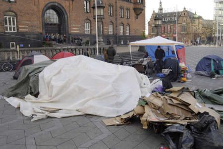 occupy wall street: DENMARK  COPENHAGEN _5th day  Few danes have Occupied Infront of Copenhagen City Hall in conection sympthaized with United States Occupy Wall Street 19 Oct. 2011          Editorial