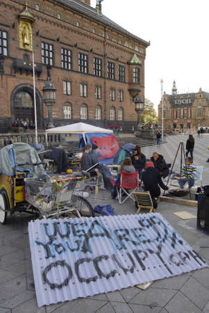 conection: DENMARK  COPENHAGEN _5th day  Few danes have Occupied Infront of Copenhagen City Hall in conection sympthaized with United States Occupy Wall Street 19 Oct. 2011     Editorial