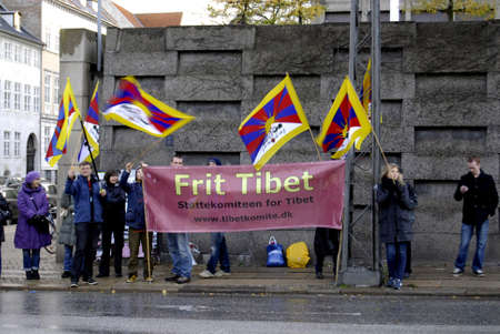 polictis: DENMARK  COPENHAGEN _  Few protesters staged rally Free Tibet to show solidarty with Tibet against Chinese foreign minister Yang Jiechi visit to Denmark and meet with danish minister for foreign affairs Villy Savndal 19 Oct. 2011