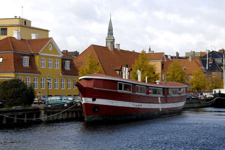 travler: DENMARK  COPENHAGEN _ Big boat in canal just one of city tourists attractions 20 Oct. 2011     Editorial