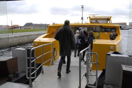 sone: DENMARK  COPENHAGEN _  Habor transportation danish public transport system link Holmen island and main city of Copenhagen if sone one has tikcet of train bus or metro can be use with habor transportations system which is owned by main transportation syst