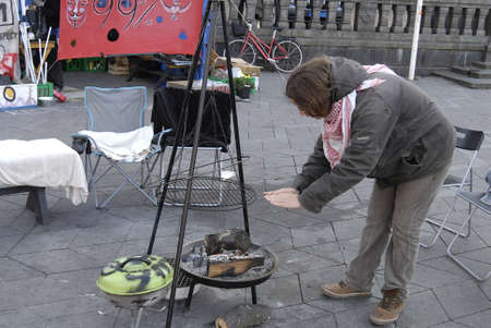 occupy wall street: DENMARK  COPENHAGEN _ Danes are show less less interest for sympathing with Occupy  Wall Street  few day police removed tents from City hall Sq. nw City Hall has given them promission to stay at city hall sq. there are only 2 tents remain atCopenhagen  C Editorial