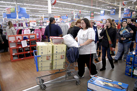 USA/WASHINTON STATE/ CLARKSTON_After thanks giving Black friday shoppers with thier favority goods at Wal-Mart(Walmart)on thanks giving evening on 24 Nov. 2011