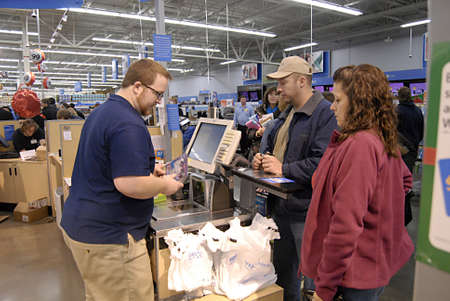 USAWASHINTON STATE CLARKSTON_After thanks giving Black friday shoppers with thier favority goods at Wal-Mart(Walmart)on thanks giving evening on 24 Nov. 2011