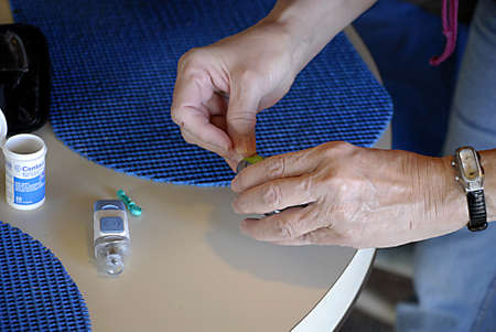 presure: USAIDAHO STATE LEWISTON _ Senior medical worker preparing  Contour blood glucose testing sytem blookd presure 28 Nov. 2011     Editorial