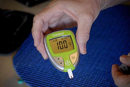 presure: USAIDAHO STATE LEWISTON _ Senior medical worker preparing  Contour blood glucose testing sytem blookd presure 28 Nov. 2011