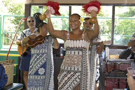 vacationers: KAUAII  HAWAII USA _ Native hawaiian musician sna ddancers entertaining holiday makers (vacationers) for river tour at smith family 29 Oct. 2011