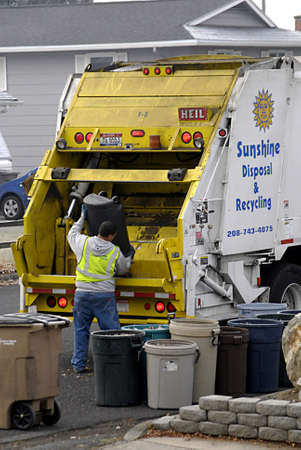 polictics: USAIDAHO STATE LEWISTON _ Worker from Sunshine disposal and recycling empty leaves waste 8 Dec. 2011      Editorial