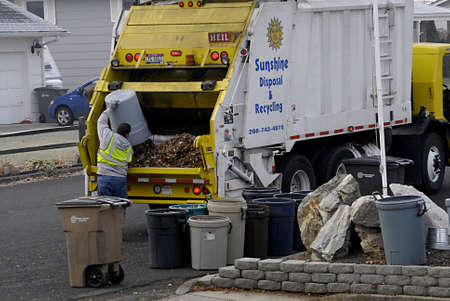USAIDAHO STATE LEWISTON _ Worker from Sunshine disposal and recycling empty leaves waste 8 Dec. 2011