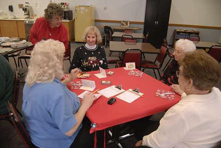 polictics: USAIDAHO STATE LEWISTON _American female senior citizen playing cards at Lewiston community center 10 Nov. 2011