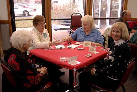 aging american: USAIDAHO STATE LEWISTON _American female senior citizen playing cards at Lewiston community center 10 Nov. 2011
