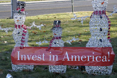 polictics: USAIDAHO STATE LEWISTON _Santa clous message in christmas spirit Invest in Ameerica message on side way road for passing byers 10 Dec. 2011