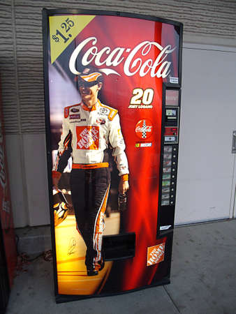 polictics: USAIDAHO STATE LEWISTON _  Sportman from The Home Depot on coca cola commercial  vending machine at The Home Depot 11 Dec. 2011       Editorial